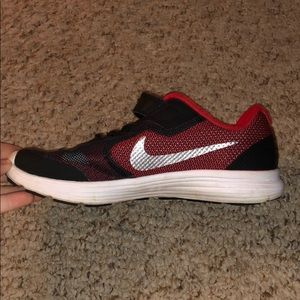 Little boys red and black NIKE sneaker